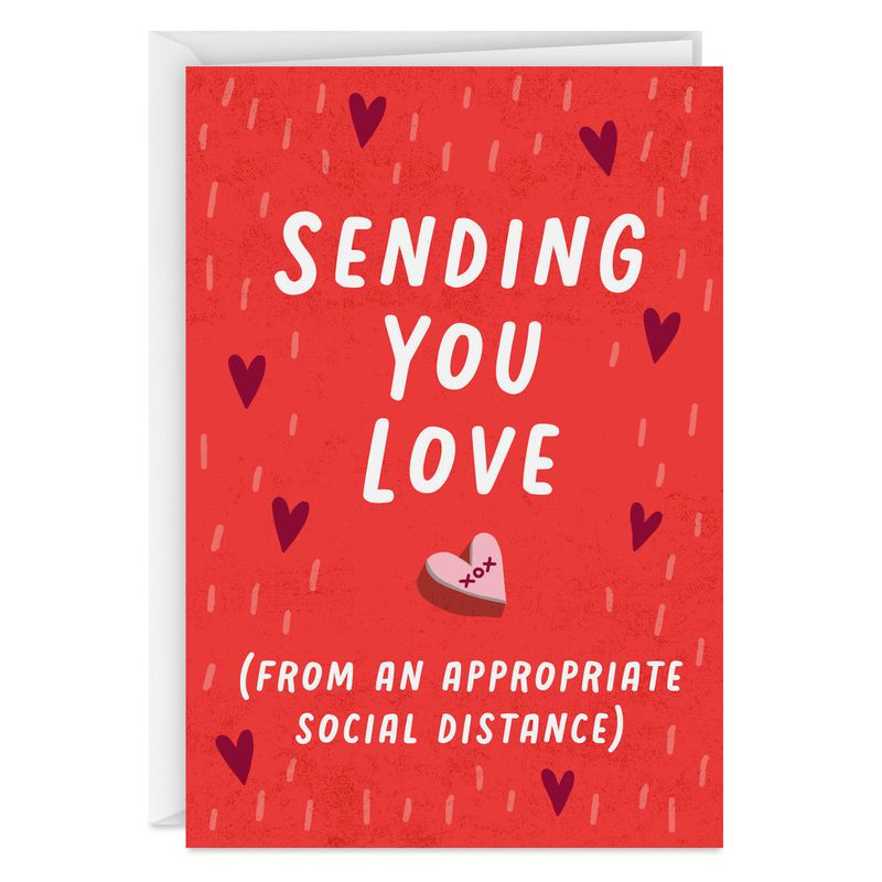 """A card with a candy heart reading """"Sending you love (from an appropriate social distance)"""""""