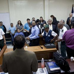 In this Aug. 20, 2012 photo, U.S. citizen Jason Sachary Puracal, center in blue shirt, is escorted out of court after his appeal hearing in Granada, Nicaragua. As a three-judge appellate panel mulls the 35-year-old American's fate, the case has drawn the scrutiny of U.S. lawmakers and human-rights advocates, including the California Innocence Project, which works to absolve people who have been wrongfully convicted. In late 2010 masked policemen raided his seafront real estate office and took him to Nicaragua's maximum security prison. Prosecutors charged that Puracal was using his business as a front for money laundering in a region used to transport cocaine from Colombia to the United States. Because no drugs or cash were seized, Puracal's family and friends thought he wouldn't be held long, but nine months later, a judge convicted Puracal and sentenced him to 22 years in prison.