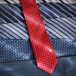 Each tie has a small logo that represents a country. The red tie displayed here is the Town and Co. tie for Peru.