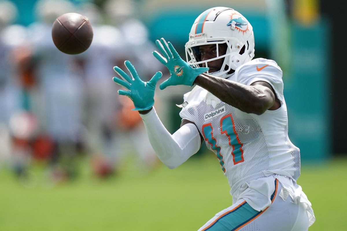 Miami Dolphins wide receiver DeVante Parker (11) attempts to catch a pass during training camp at Baptist Health Training Complex.