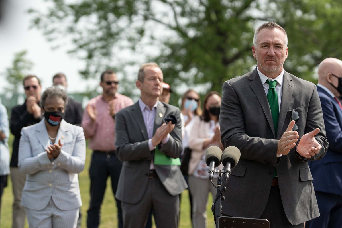 Chicago Park District Supt. Mike Kelly (right) during a press conference and groundbreaking ceremony in June for the AIDS Garden on the lakefront near Belmont Harbor. Behind him are Chicago Mayor Lori Lightfoot (left) and Ald. Tom Tunney (center).
