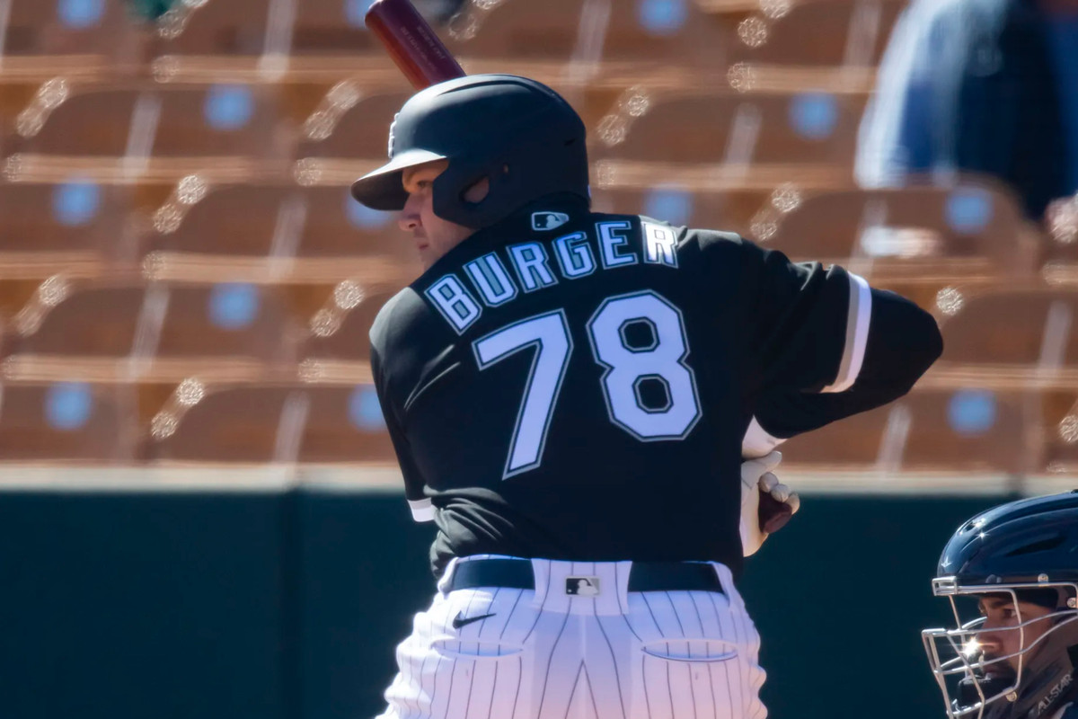 Jake Burger, #78, in a White Sox uniform batting from behind, looking left