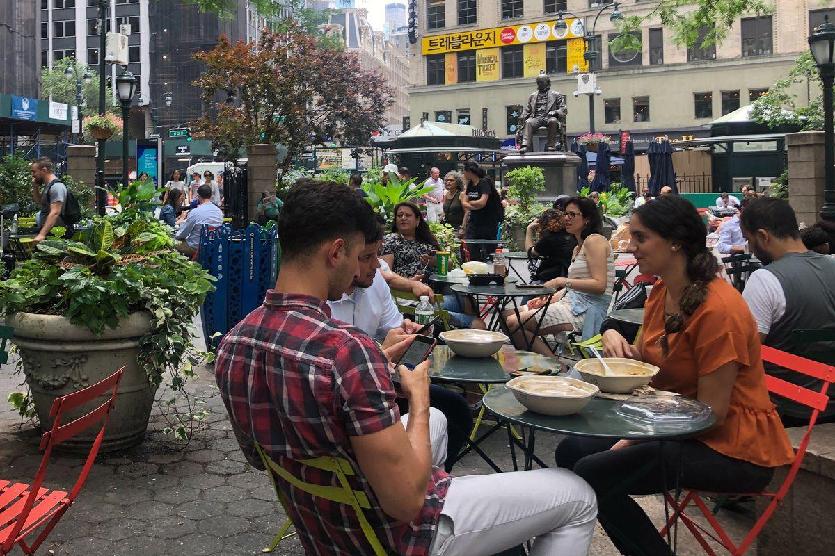 People eat in Herald Square before the coronavirus outbreak.