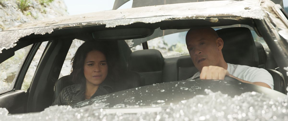 Letty and Dom sit in a car with a broken windshield in F9