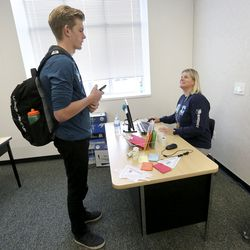 Cole Saxey talks to Hillcrest High School counselor Kim Walters after applying to the University of Utah during Utah College Application Week at the Midvale school on Tuesday, Oct. 22, 2019.