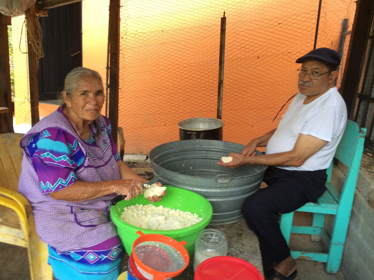 """""""Don Samuel"""" processing cheese with his mother-in-law Nicasia on a visit to San Francisco, his Guerrero hometown."""