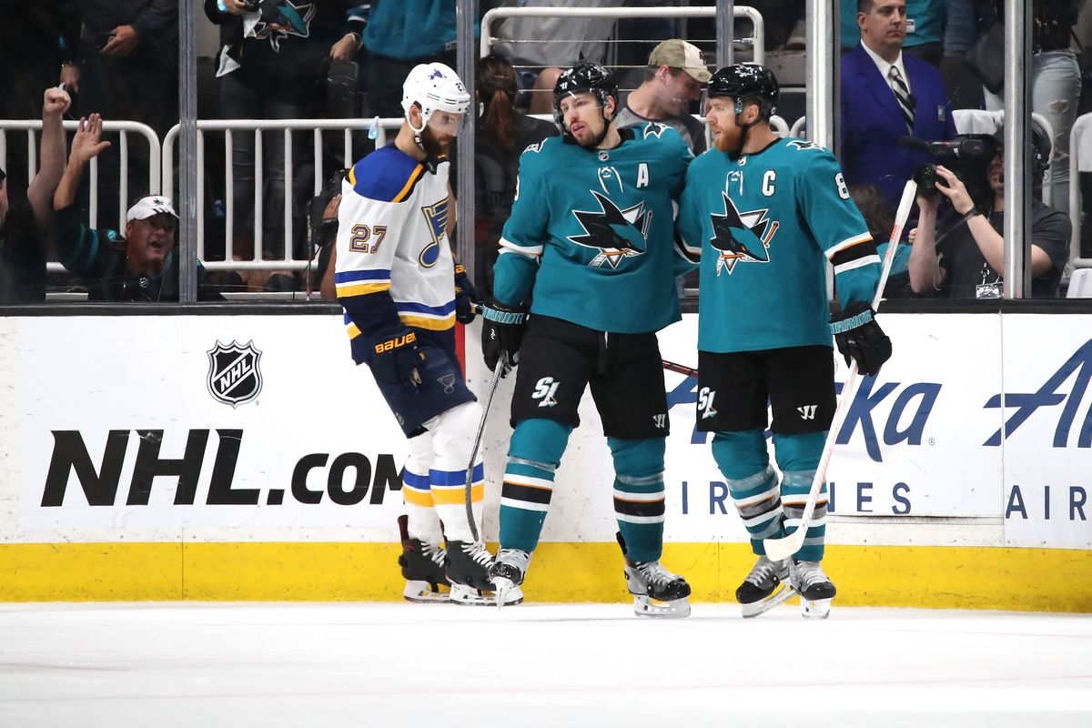 Logan Couture of the San Jose Sharks celebrates with Joe Pavelski after scoring an empty net goal against the St. Louis Blues during the third period in Game 1 of the Western Conference Finals during the 2019 NHL Stanley Cup Playoffs at SAP Center on May