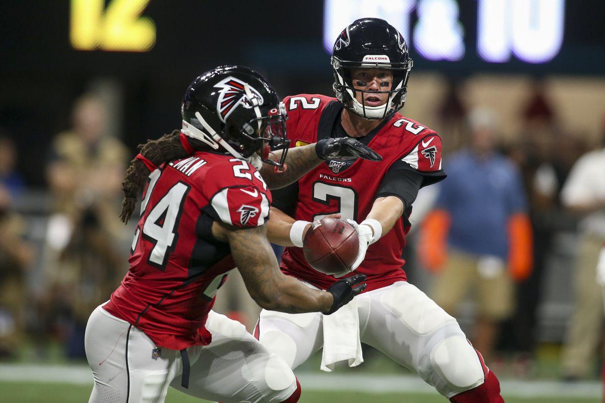 Falcons quarterback Matt Ryan hands the ball off to running back Devonta Freeman against the Eagles at Mercedes-Benz Stadium.