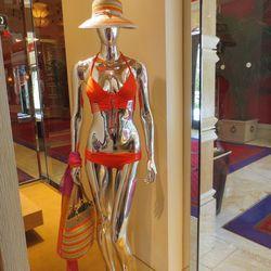 Cayenne bikini top, $145, and bottom, $85, and Eric Javits straw hat, $175, and Eric Javits straw tote, $355.