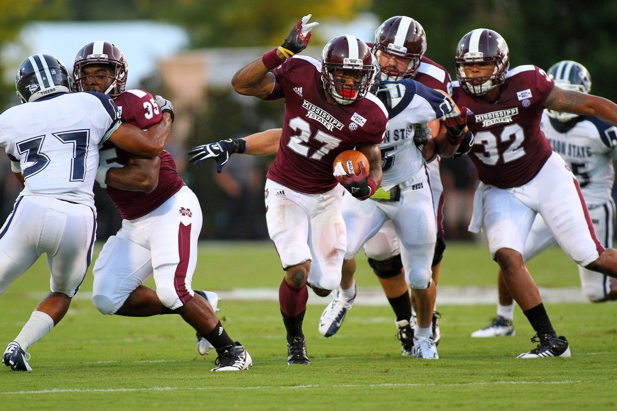 Sept 1, 2012; Starkville, MS, USA;  Mississippi State Bulldogs running back LaDarius Perkins (27) advances the ball for extra yardage during the game against the Jackson State Tigers at Davis Wade Stadium. Mandatory Credit: Spruce Derden–US PRESSWIRE