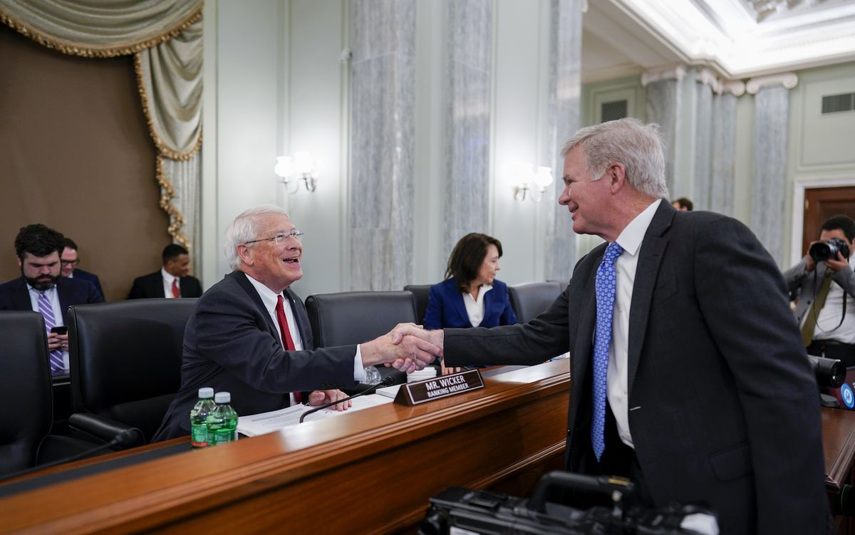 Sen. Roger Wicker, R-Miss., greets NCAA President Mark Emmert at a hearing on student athlete compensation in Washington.