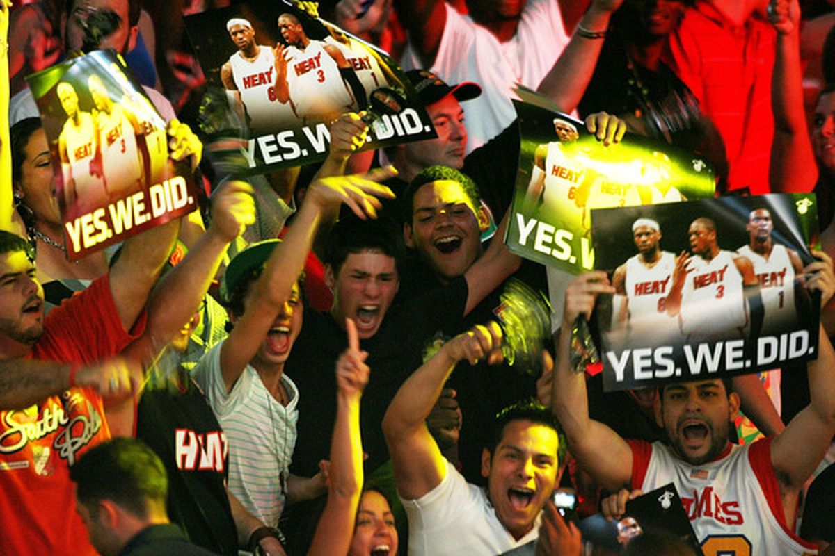 MIAMI - JULY 09:  Fans cheer as Chris Bosh #1 Dwyane Wade #3 and LeBron James #6 of the Miami Heat are introduced during a welcome party at American Airlines Arena on July 9 2010 in Miami Florida.  (Photo by Marc Serota/Getty Images)