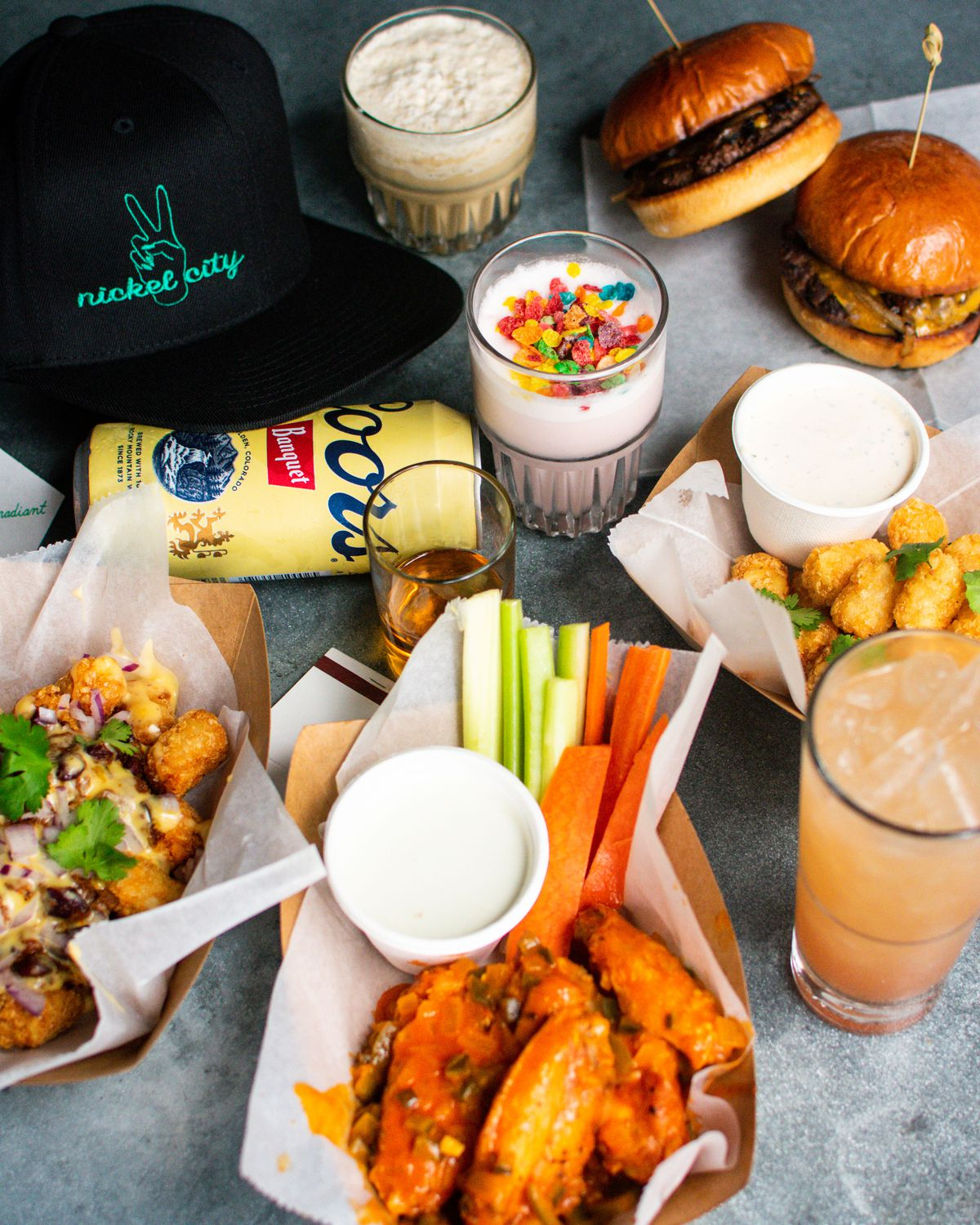 The hat, food, and drinks from Nickel City's pop-up at Irene's