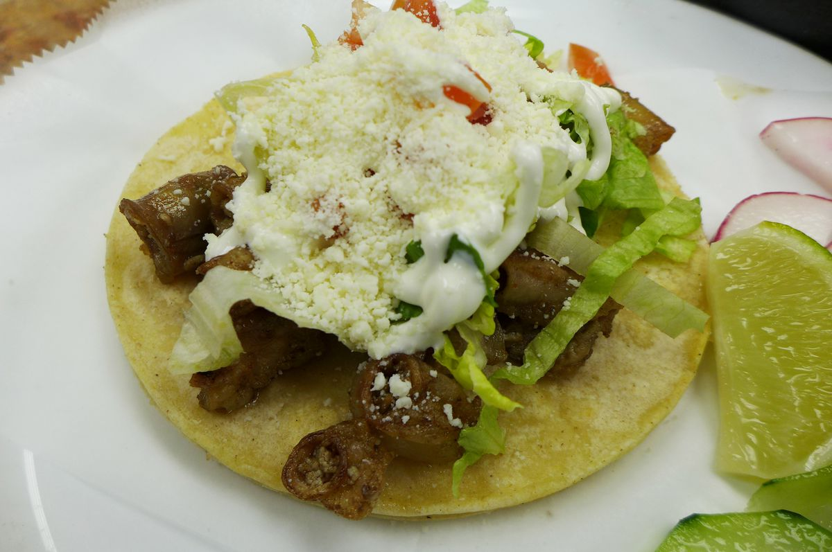 Put green salsa on this chewy tripe taco.