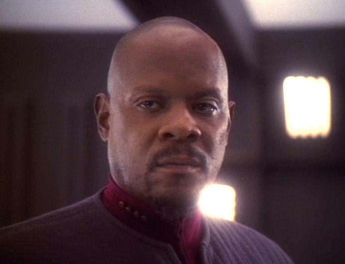 Sisko in his blue uniform in Star Trek: Deep Space Nine