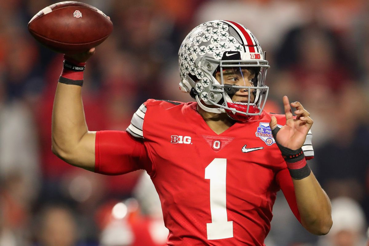 Quarterback Justin Fields of the Ohio State Buckeyes throws a pass during the PlayStation Fiesta Bowl against the Clemson Tigers at State Farm Stadium on December 28, 2019 in Glendale, Arizona.