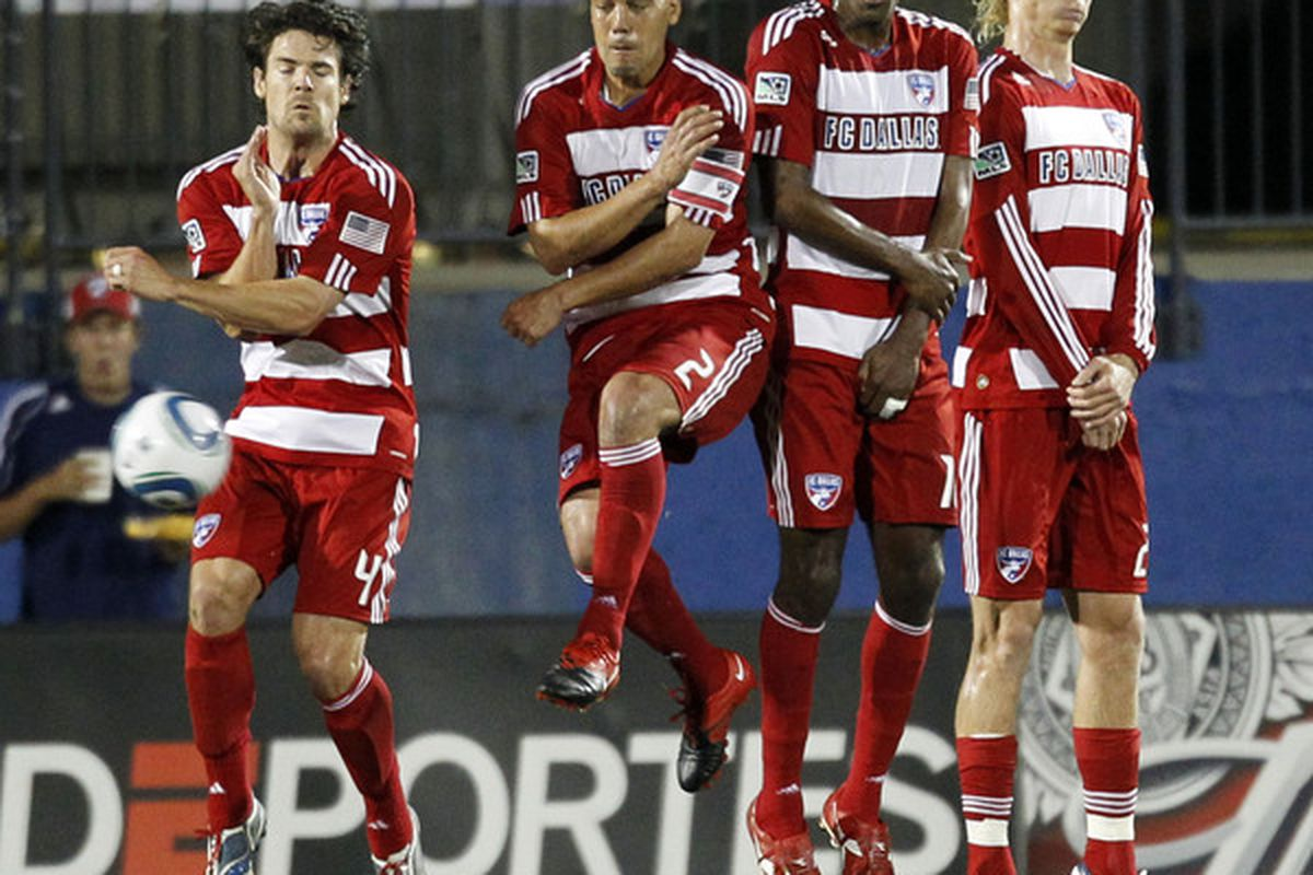 FRISCO, TX - MAY 8: Heath Pearce #4, Daniel Hernandez #2, Atiba Harris #16 and Brek Shea #20 of FC Dallas form a wall and deflect the ball against D.C. United at Pizza Hut Park on May 8, 2010 in Frisco, Texas. (Photo by Layne Murdoch/Getty Images)
