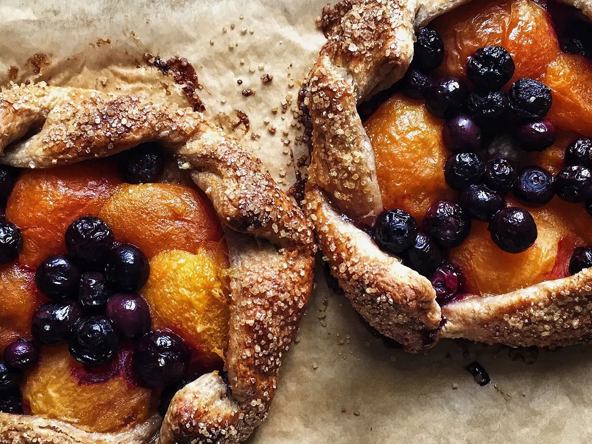 Two peach and blueberry tarts