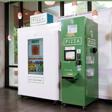 A green and white machine with a touchscreen pizza menu