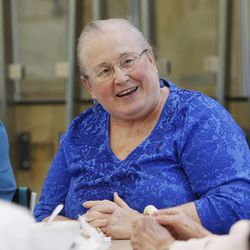 Barbara Patrick talks with friends while eating lunch at Millcreek Senior Center in Salt Lake City Wednesday, May 21, 2014.