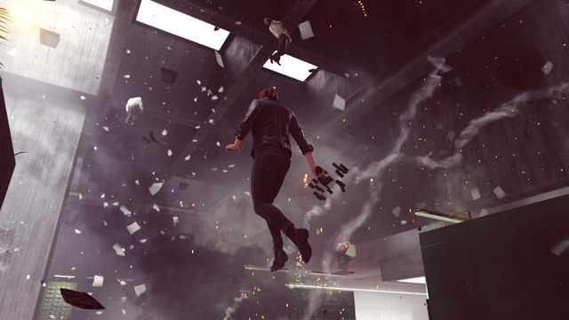 a woman floats in an office, with debris flying everywhere around her