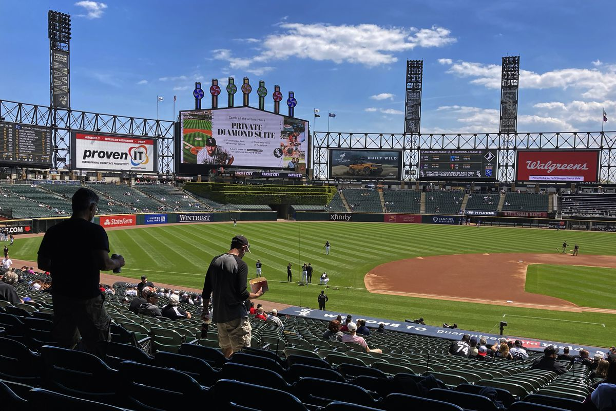 Baseball fans arrive for the first game of a baseball double header between the Chicago White Sox and the Kansas City Royals Friday, May 14, 2021, at Guaranteed Rate Field in Chicago.