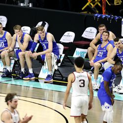 BYU players and staff watch as the game nears an end as they fall 88-78 to Gonzaga in the finals of the West Coast Conference tournament at the Orleans Arena in Las Vegas on Tuesday, March 9, 2021.