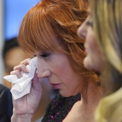 Comedian Kathy Griffin wipes her eyes as she stands with her attorney Lisa Bloom during a news conference, Friday, June 2, 2017, in Los Angeles, to discuss the backlash since Griffin released a photo and video of her displaying a likeness of President Donald Trump's severed head.