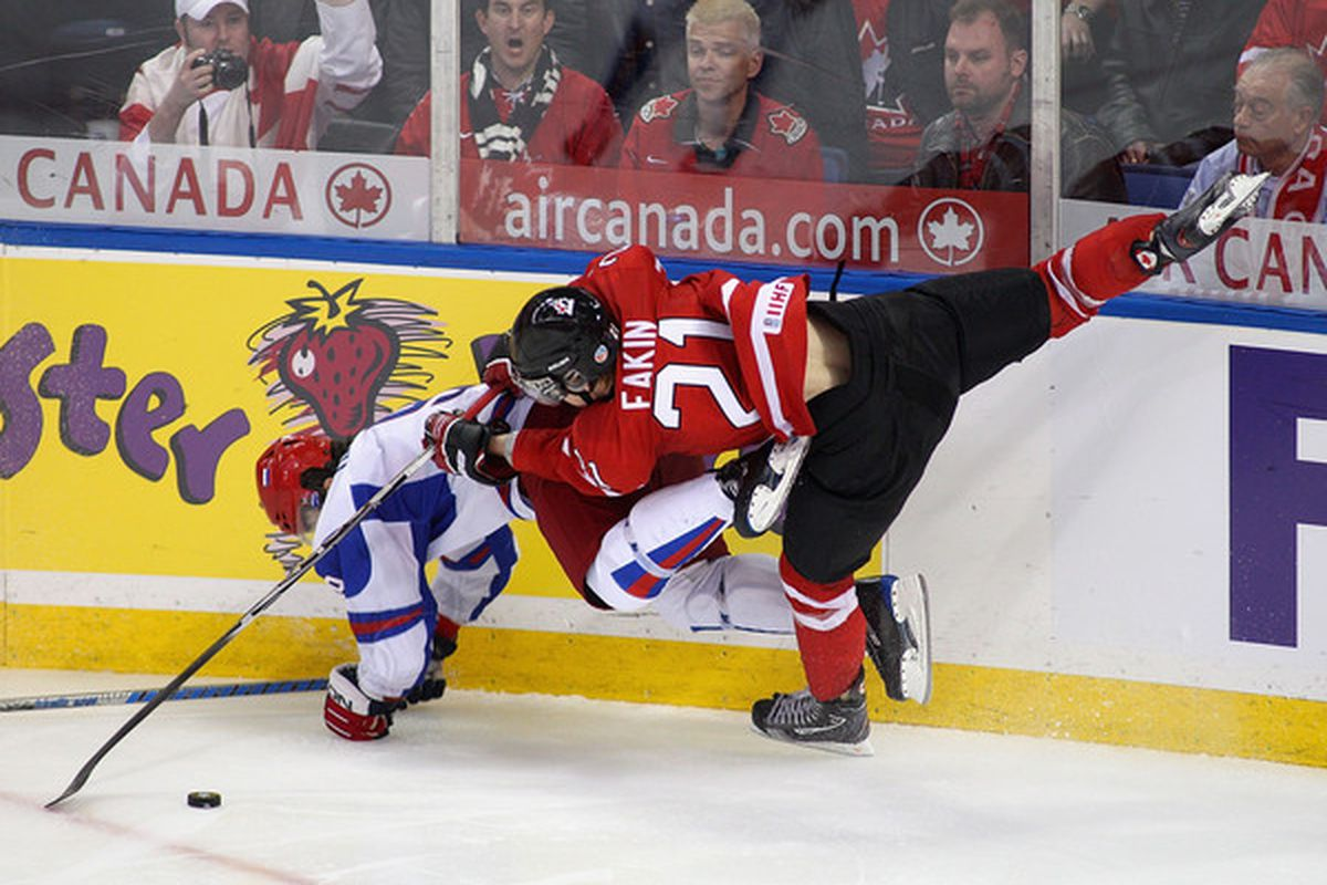 Dmitri Orlov of Russia and Cody Eakin of Canada collide in the air during the 2011 IIHF World U20 Championship Gold medal game between Canada and Russia on January 5 2011 in Buffalo New York. Russia won 5-3 to take the gold medal.