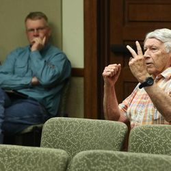 Art Cooper, a resident, talks during a Garfield County Commission meeting Monday, June 8, 2015, in Panguitch, discussing county economic troubles and declining school enrollment since 1996.