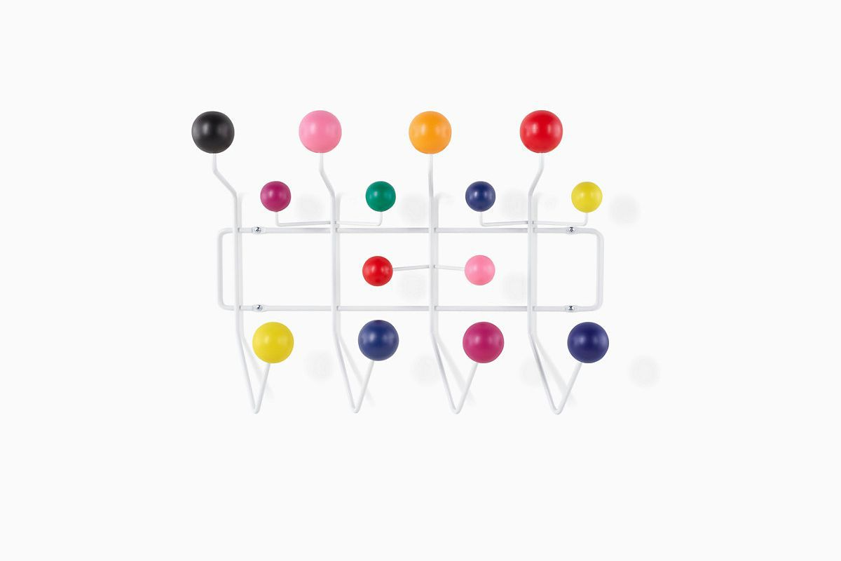 Hanger with white hooks and multi-colored spherical knobs.