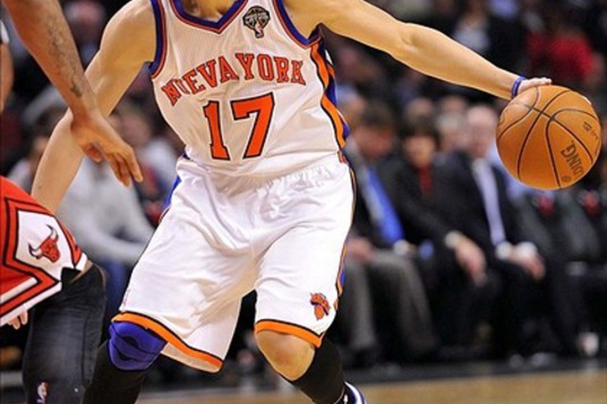 Mar 12, 2012; Chicago, IL, USA; New York Knicks point guard Jeremy Lin (17) dribbles the ball against the Chicago Bulls during the second half at the United Center. The Bulls defeat the Knicks 104-99.  Mandatory Credit: Mike DiNovo-US PRESSWIRE