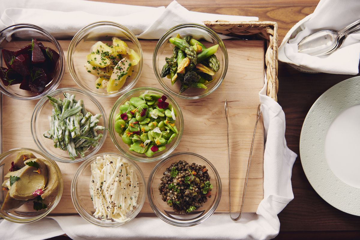 Marinated beets, celery remoulade, blanched asparagus, artichoke barigoule, leeks vinaigrette, marinated haricot verts, and lentil salad in the tableside vegetable cart