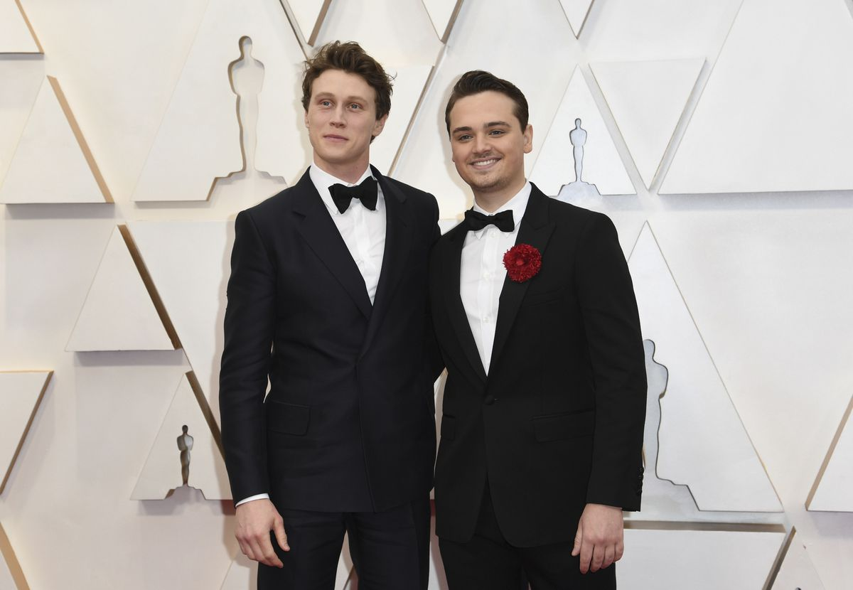 """George MacKay (left) and Dean-Charles Chapman, currently starring in the Oscar-nominated """"1917"""" arrive at the Oscars on Sunday night."""