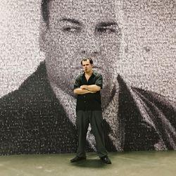 Tony Soprano impersonator Nicky Petito stands in front of a James Gandolfini mural