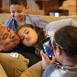 Skye Sitake takes a photo of Kalani Sitake, Sadie Sitake, 8, and KK Sitake, 5, at home in Provo on Friday, March 11, 2016.