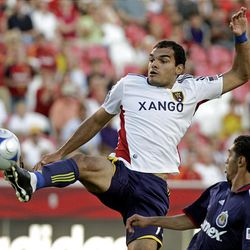 Pablo Campos goes high to get the ball in front of Chivas USA's Mariano Trujillo Wednesday at Rio Tinto Stadium.