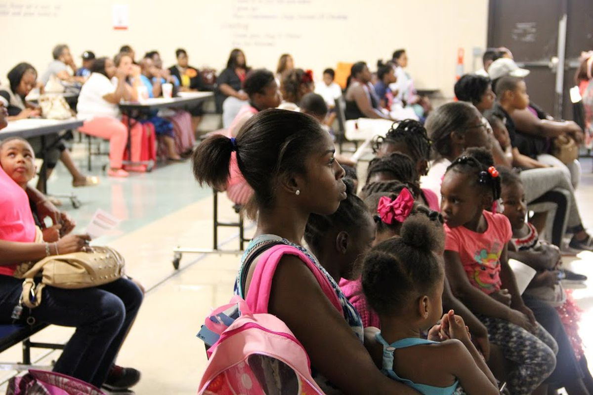 Parents at Caldwell-Guthrie Elementary School listen to a presentation by Shelby School leaders on Aug. 20 about the Memphis school's status as a state priority school. On Thursday, state officials named Caldwell-Guthrie one of six schools that may taken from local district control and converted to a charter school.