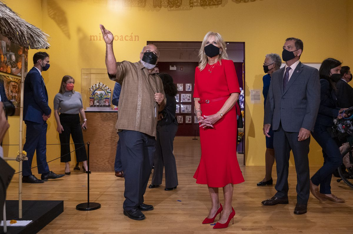 Chief Curator Cesareo Moreno shows first lady Jill Biden and local elected officials a Day of the Dead Exhibit during a visit and tour of the National Museum of Mexican Art in Pilsen on Tuesday.