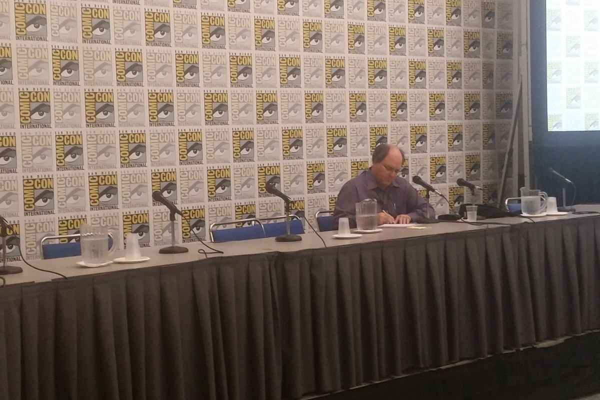 John Rogers, president of Comic-Con, writes down issues Con attendees have had with the event.