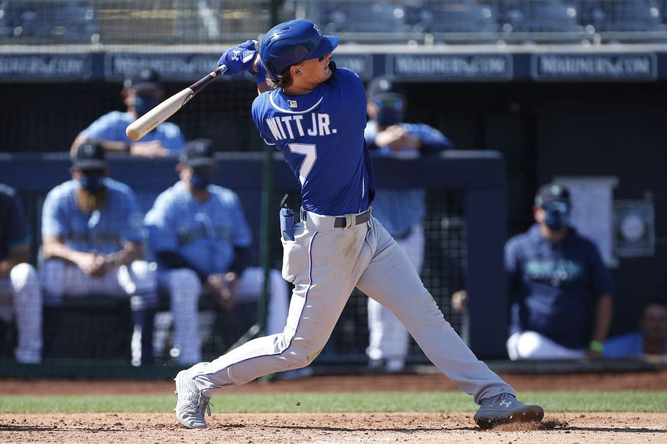 Bobby Witt Jr. #7 of the Kansas City Royals swings during an at bat against the Seattle Mariners in the third inning of the MLB spring training baseball game at Peoria Sports Complex on March 09, 2021 in Peoria, Arizona.