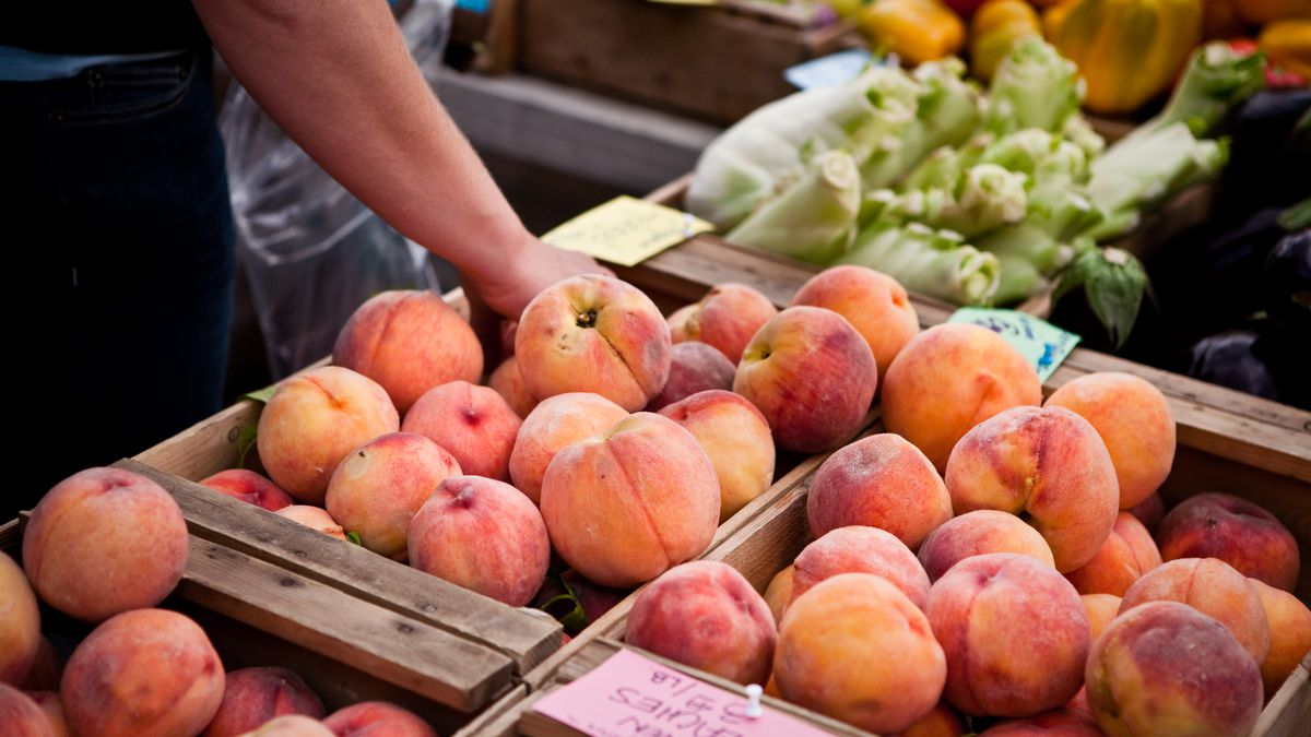 Baskets full of peaches at the Ballard farmers market in Seattle