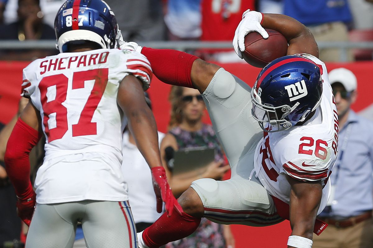 Running back Saquon Barkley of the New York Giants is tackled by defensive back M.J. Stewart of the Tampa Bay Buccaneers in the second quarter during the game at Raymond James Stadium on September 22, 2019 in Tampa, Florida.