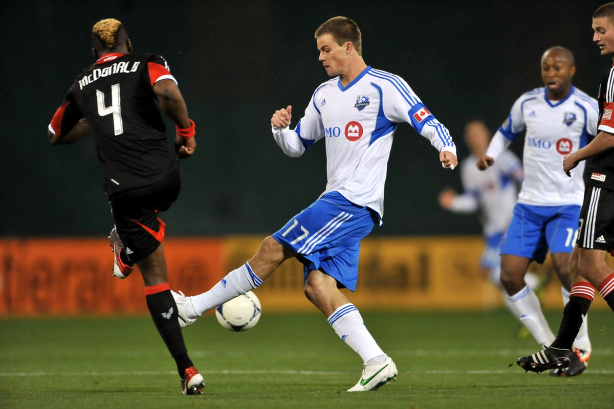 WASHINGTON, DC - APRIL 18:  Justin Braun #17 of Montreal Impact controls the ball against Brandon McDonald #4 of D.C. United at RFK Stadium on April 18, 2012 in Washington, DC. Montreal Impact tied D.C United 1-1. (Photo by Larry French/Getty Images)
