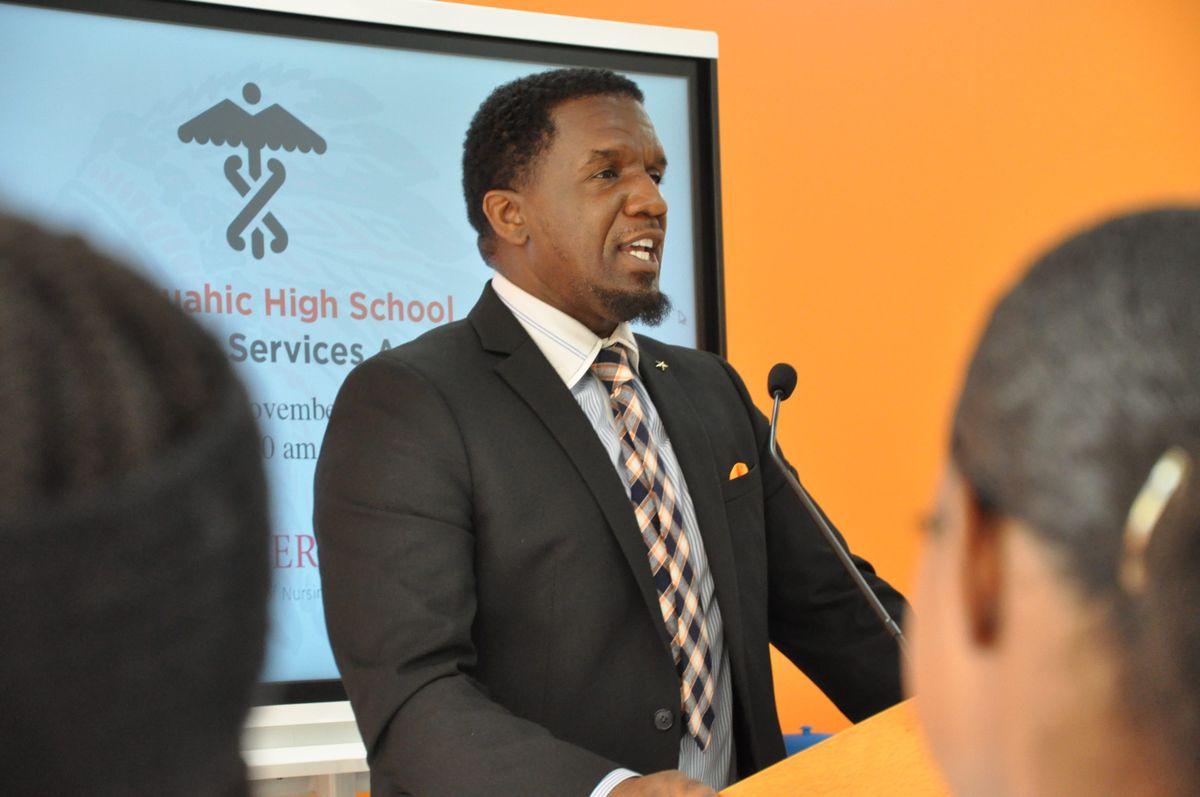 Weequahic High School principal Andre Hollis announces the school's new allied health program.