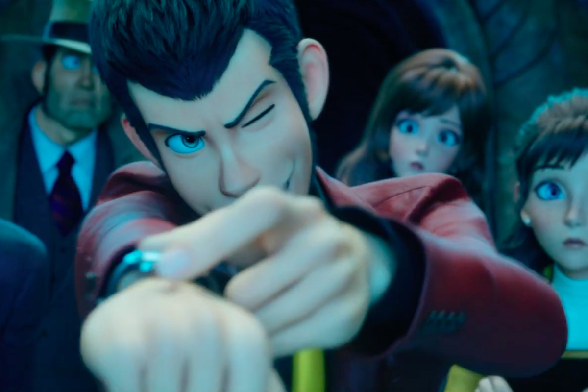 A man points his wrist at the screen, twisting something on his watch. Five other people are in the background, looking on.