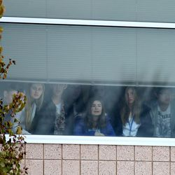 Students look out a window of Pleasant Grove High School during a lockdown Thursday, Dec. 3, 2015. Pleasant Grove High School was placed on lockdown after receiving reports of a man with a weapon inside the school.