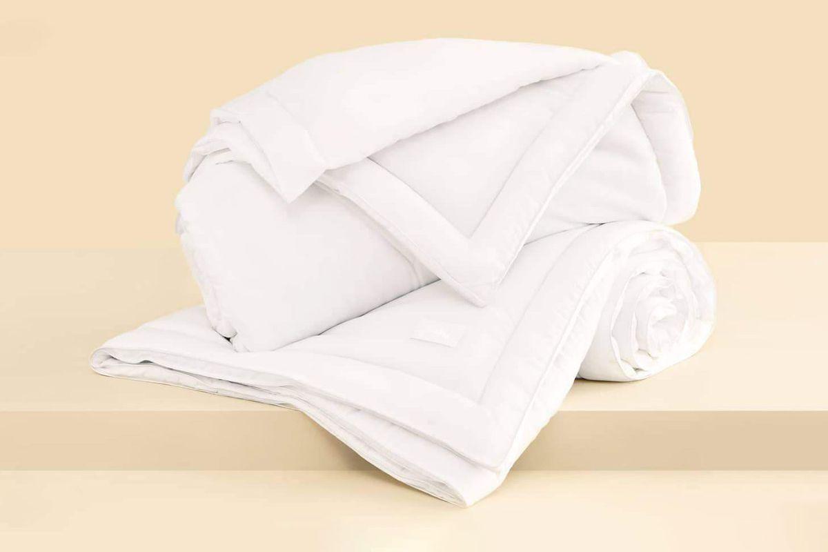 Folded up white bedding.
