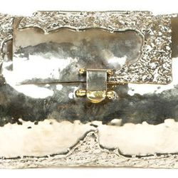 """<b>Anndra Neen for Opening Ceremony</b> Melted Mirror Clutch in brass/silver, <a href=""""http://www.openingceremony.us/products.asp?menuid=2&catid=24&subcatid=75&designerid=1628&productid=71194"""">$670</a> at Opening Ceremony"""