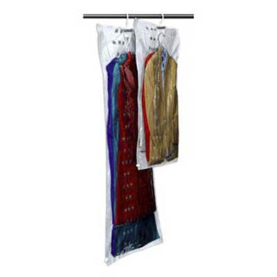 Garment bags hanging on a rod with tree skirts and table clothes stored inside them.